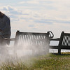Jim Vaiknoras/Gloucester Daily Times: <br /> DPW worker Shawn Johnsontakes advantage of the beautiful fall weather to powerwash the benches on Singing Beach in Manchester Monday afternoon.