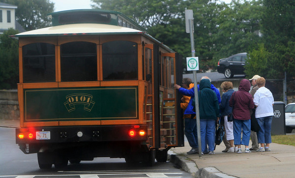 ALLEGRA BOVERMAN/Gloucester Daily Times the Holland America's Veendam cruise ship was in Gloucester on Tuesday. The Cape Ann Transit Authority (CATA)  provided trolleys for travellers who came ashore to get around Gloucester and even to Rockport if they wanted.