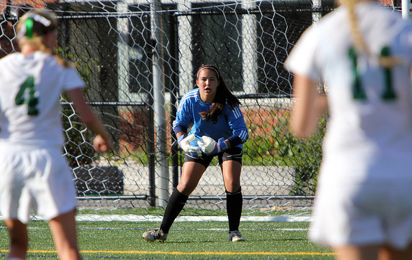 Allegra Boverman/Gloucester Daily Times Marblehead Varsity Grls Soccer goalie Cassandra Rodgers, center, in action against Manchester Essex on Tuesday afternoon in Manchester.