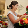 Allegra Boverman/Gloucester Daily Times Celia Gibson, of Celia's Flower Studio in Lanesville, preparing for a very busy weekend of weddings on Friday afternoon. She was doing flowers for six different weddings with the help of two friends who are also her assistants, including Sueky Ginsberg, left, of Beverly, and Elise Jillson of West Gloucester, not shown.
