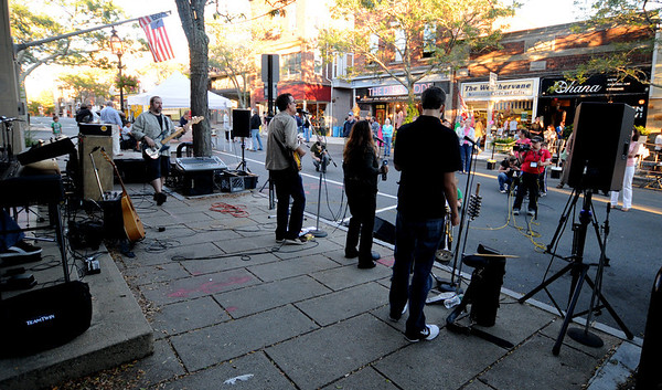 Jim Vaiknoras/Gloucester Times: The band Teal Street perform at the Downtown Gloucester Block Party Saturday night on Main Street.