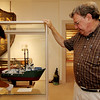 ALLEGRA BOVERMAN/Gloucester Daily Times Paul Gran, right who summers in Rockport, made this scale model of the Andrea Gail which is now on display at the Cape Ann Museum. Leon Doucette, left, a curatorial assistant, puts the ship back into its display case.