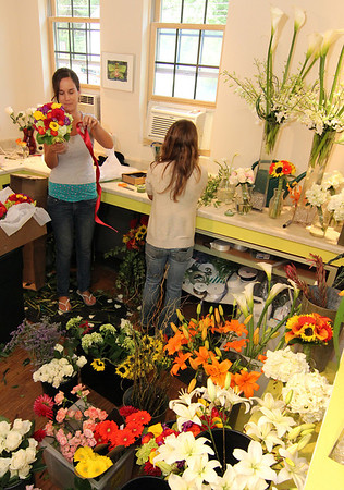 Allegra Boverman/Gloucester Daily Times At left, Celia Gibson of Celia's Flower Studio in Lanesville was preparing for a very busy weekend of weddings on Friday afternoon. She was doing flowers for six different weddings with the help of two friends who are also her assistants, including Elise Jillson, right, of West Gloucester.