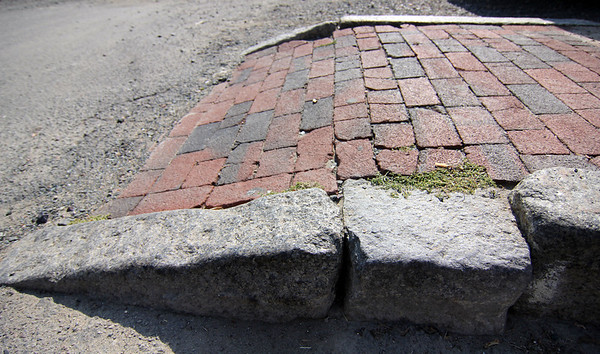 Allegra Boverman/Gloucester Daily Times Granite curbing along Commercial Street in Gloucester. It was hand-cut from Cape Ann granite and dates back to the 1800s.