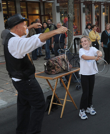 Jim Vaiknoras/Gloucester Times:Madelyn Dixon, 9, of Rockport assists magician Joe Howard with a trick at the Downtown Gloucester Block Party Saturday night on Main Street.
