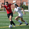 Allegra Boverman/Gloucester Daily Times Marblehead Varsity Girls Soccer player Meggie Collins, left, in action against Manchester-Essex's Emily Moore during their game in Manchester on Tuesday afternoon.