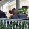Allegra Boverman/Gloucester Daily Times Julie Andrews of Rockport was having lunch and reading on her porch on Friday afternoon during a calm time before the end of the school day.