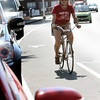 ANGIE BEAULIEU/Staff photo. Cyclist Heidi Wakeman uses a new bike lane along Rogers Street. 08/21/13