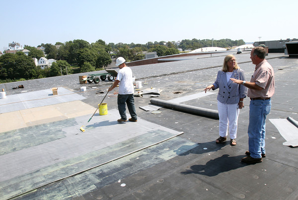 ANGIE BEAULIEU/Staff photo. Mayor Carolyn Kirk and James Hafey, DPW Facilities Manager, discuss work being done on the roof at Gloucester High School. 08/21/13