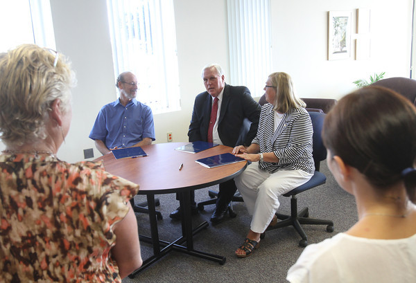 ANGIE BEAULIEU/Staff photo. From left, Dr Richard Safier, Superintendent of Schools, Dr. Richard Wylie, President of Endicott College, and Mayor Carolyn Kirk sit down to sign the dual enrollment program between the college and Gloucester High School. 08/21/13