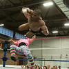 """DESI SMITH/Staff photo.  Bobby Ocean came off the ropes and landed a kick to the chest on his opponent """"Adorable"""" Danny Miles, sending him to the mat, Friday night at the O'maley Rink for the Police Relief Assoiation Wrestling. Miles won the match on a tap out by Ocean.  August 16,2014"""