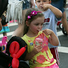 AMY SWEENEY/Staff photo. Ava Harrington, 3, and Cameron Oliveira, 3, both from Gloucester, enjoy their slushes during a day at the Sidewalk Bazaar.   8.7.14