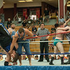 """DESI SMITH/Staff photo.  """"The Country Boys"""" (in jeans) Lumber Jake,Cousin Larry and Hunter Ward, take care of business in a tag team match against Big Bear Matouch ,Beau Douglass and Kyle Huntly, Friday night at the O'maley Rink for the Police Relief Assoiation Wrestling.  August 16,2014"""