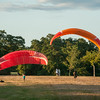 DESI SMITH/Staff photo.  A pair of paragliders check out their canopy's at Stage Fort Park on a recent afternoon just before sunset.  August 16,2014