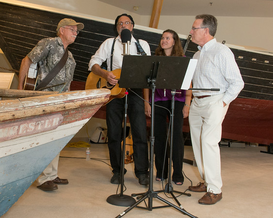 "DESI SMITH/Staff photo.   From left to right, Ernie Pigion, Peter Souza, Audi Souza,and Barry O'Brien entertain the guest as they sing ""Drunken Salior"" during a gala celebration at the re-opening of the Cape Ann Museum saturday night, after a 10-month renovation that reconfigured and opened up a number of the galleries, as well as upgrading the electrical, hvac and security systems to modern code.  August 16,2014"