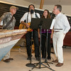 """DESI SMITH/Staff photo.   From left to right, Ernie Pigion, Peter Souza, Audi Souza,and Barry O'Brien entertain the guest as they sing """"Drunken Salior"""" during a gala celebration at the re-opening of the Cape Ann Museum saturday night, after a 10-month renovation that reconfigured and opened up a number of the galleries, as well as upgrading the electrical, hvac and security systems to modern code.  August 16,2014"""