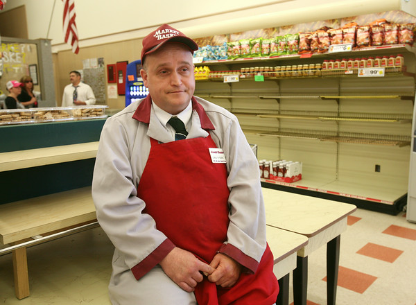 AMY SWEENEY/Staff photo. Dave D'Angelo, assistant deli manager at the Market Basket at Gloucester Crossing, talks about the impact the demonstrations are having at the grocery store where he has worked for 15 years. 8.07.14