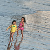 DESI SMITH/Staff photo.   Two girls chase after each other as they enjoy their day at Front Beach Thursday afternoon in Rockport.    August 28,2014
