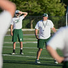 RYAN HUTTON/ Staff photo.<br /> Head coach Mike Athanas gives a pep talk in the middle of a pursuit drill during Manchester/Essex Regional High School football practice on Wednesday night.