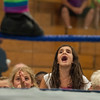 """DESI SMITH/Staff photo.  Adriana Aiello 8, of Gloucester, taunts """"Adorable"""" Danny Miles as he stands on the ropes while in a match with Bobby Ocean Friday night at the O'maley Rink for the Police Relief Assoiation Wrestling.  August 16,2014"""