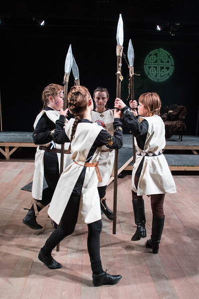 Desi Smith/Staff photo.     Messengers (from center left to right) Willa Brosnihan, Erin Deady, Abbie Zucker and Elizabeth Wagner act out a scene during a dress rehearsal for Cape Ann Shakespeare Troupe King Lear Tuesday night at the Gloucester Stage Company.    April 26,2017