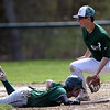 DAVID LE/Staff photo. Manchester-Essex first baseman Jackson Levendusky, right, can't slap the tag on Pentucket's Ryan DePaolo in time as he dives back to first on a pickoff attempt. 4/23/16.