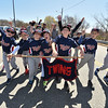 "Desi Smith/Staff photo.   The Twins are all fired up as the parade down Dr. Osman Babson Road during the Gloucester Little League parade and season openner Saturday morning on Dr. Osman Babson Road, where they also held a field dedication ceremony naming a new field in honor of Harold ""Bucky"" Rogers.      April 30,2016"