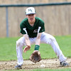 DAVID LE/Staff photo. Manchester-Essex second baseman ______ fields a grounder and throws out a Pentucket runner. 4/23/16.
