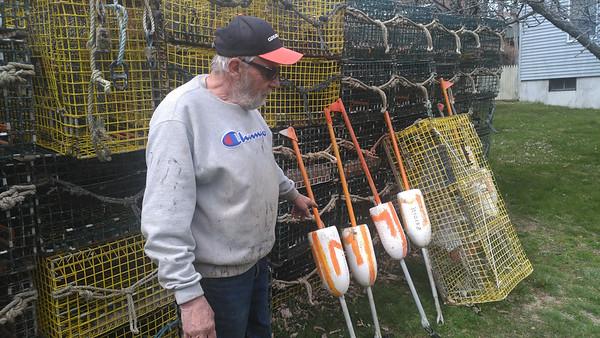 SEAN HORGAN/Lobsterman Joe Mondello has stacked his tracks and buoys at his father's home on Mondello Square.