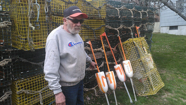 SEAN HORGAN/Lobsterman Joe Mondello has stacked his tracks and buoys at his father's home on Mondello Square.