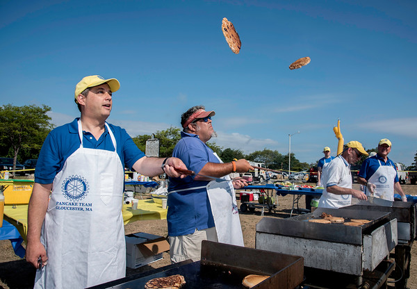 Desi Smith Photo.     State Senator Bruce Tarr and Rick Doucette show off their pancake flipping skills, while helping out at the Gloucester Rotary Club's Annual Pancake Breakfast held Saturday morning from 7:30 a.m. to 11 at Stage Fort Park next to the band stand.   August 20,2016