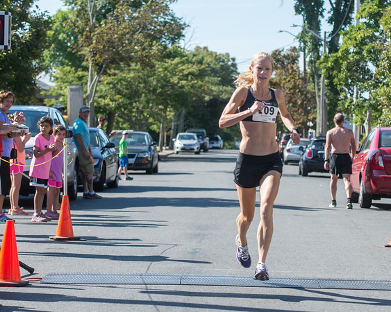 Desi Smith Photo.    Magnolia's Layce Alves is cheered on as she crosses the finish, placing first for the women, in the Magnolia 5k Road Race held Saturday morning in Magnolia.  August 27,2016