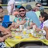 Desi Smith Photo.    Chris Sicuranza (center) of Gloucester enjoys a laugh with family and friends during the Gloucester Rotary Club's Annual Pancake Breakfast held Saturday morning at Stage Fort Park.  August 20,2016