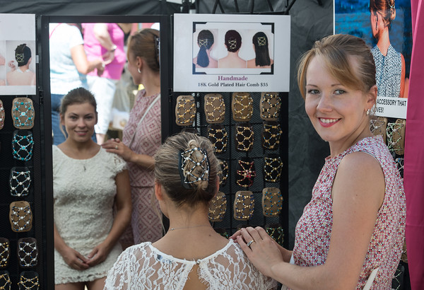 Desi Smith Photo.  Designer Kateryna G of Fancycombs (right) shows of her collection with the help from Darina Pogodina at the Annual Gloucester Waterfront Festival held Saturday at Stage Fort Park.  August 20,2016
