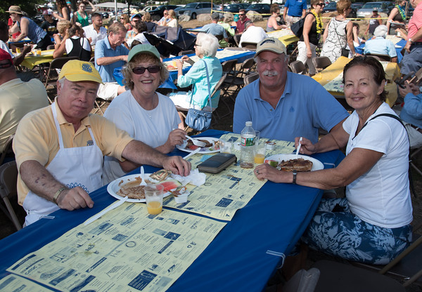 Desi Smith Photo.     From left, Rotarian Roger Armstrong his wife Sharron,Rick Hemeon and Jayne Ginn of Gloucester,enjoy great weather and a panckke breakfast at the Gloucester Rotary Club's Annual Pancake Breakfast held Saturday morning at Stage Fort Park next to the band stand.   August 20,2016