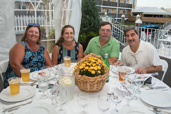 Desi Smith Photo.   Left to right, Alison Story, Cara and Mark Ring, and Vincent Mortillaro attended the Sea to Supper Celebration and fundraiser held on August 24,2017 at Mile Marker One Restaurant & Bar at Cape Ann's Marina Resort.