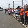 CHRISTIAN M. WADE/CHNI/Hundreds of MBTA mechanics and drivers lined Western Avenue in Lynn on Monday to protest Gov. Charlie Baker's plans to privatize bus maintenance operations at the Lynn garage and several other facilities.