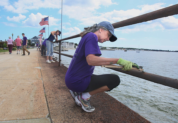 Volunteers Paint Railings at Stacy Boulevard