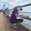 Volunteers Paint Railings at Stacy Boulevard