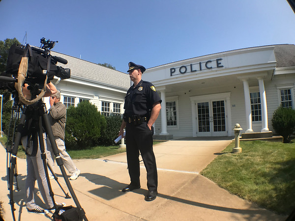 MARY MARKOS/Staff photo<br /> Rockport police Chief John Horvath gets ready to speak on camera in front of the station about the search for a suspect who exposed himself to a girl on Long Beach on Wednesday.