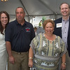 Desi Smith Photo.  From left to right, members of Fishing Partnership Support Services, Lori Caron, Todd Jesse, and J J Bartlett, came together to attended and honor Angela Sanfilippo at the Sea to Supper Celebration and fundraiser held on August 24,2017 at Mile Marker One Restaurant & Bar at Cape Ann's Marina Resort.