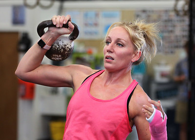 MIKE SPRINGER/Staff photo Christen Fleming of Gloucester participates in a kettlebell fitness class at Crossfit Cape Ann in Gloucester. 8/14/2018