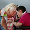 MIKE SPRINGER/Staff photo<br /> Care giver Elizabeth Crowell, left, visits with adult foster care client Mary Doubleday during Adult Foster Care of the North Shore's annual summer lobster party Monday at Gloucester House's Seven Seas Wharf.<br /> 8/6/2018