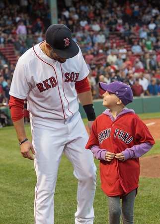 AMANDA SABGA/Staff photo <br /> <br /> Boston Red Sox designated hitter J.D. Martinez stands at home plate with honorary designator hitter Marlin Welcome, 9, of Gloucester who has acute lymphoblastic leukemia. The Red Sox took the field with Jimmy Fund kids battling cancer before a game between the Boston Red Sox and the Cleveland Indians at Fenway Park in Boston<br /> <br /> 8/21/18