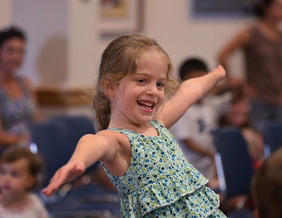 MIKE SPRINGER/Staff photo<br /> Six-year-old Drea Del Dotto Bordage dances along with the music Thursday during a puppet and music show for children at the Rockport Public Library.<br /> 8/9/2018