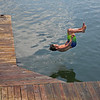 MIKE SPRINGER/Staff photo<br /> Nicholas White, 13, jumps from the dock at Lobster Cove in Annisquam.