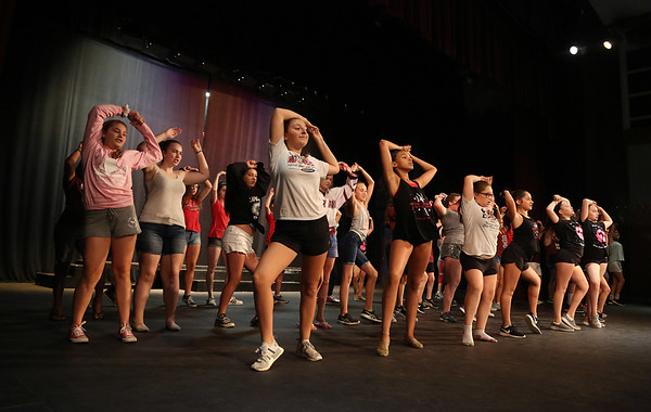 MIKE SPRINGER/Staff photo<br /> Students rehearse a scene in the O'Maley Academy Musical Theater Camp's musical review at Gloucester High School. Over 100 fourth through nineth graders are participating in the production.<br /> 8/13/2018