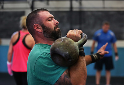 MIKE SPRINGER/Staff photo Mike Mann of Gloucester participates in a kettlebell fitness class at Crossfit Cape Ann in Gloucester. 8/14/2018
