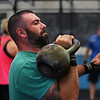 MIKE SPRINGER/Staff photo<br /> Mike Mann of Gloucester participates in a kettlebell fitness class at Crossfit Cape Ann in Gloucester.<br /> 8/14/2018
