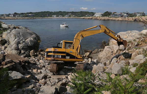 MIKE SPRINGER/Staff photo<br /> John Marchant of the Gloucester-based Great Eastern Marine uses an excavator Wednesday to clear an area for a new boat landing on Straitsmouth Island in Rockport.<br /> 8/8/2018